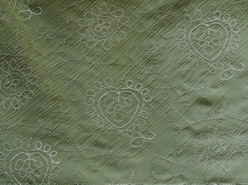 olive green fabric with design