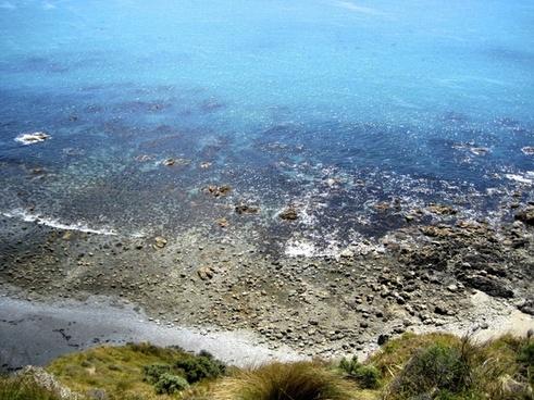 overlooking a calm rocky beach