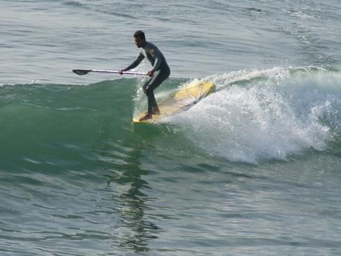 paddleboard surfer hangs five