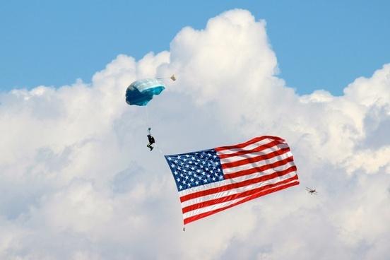 parachute parasailing clouds