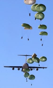 parachutes parachutists plane