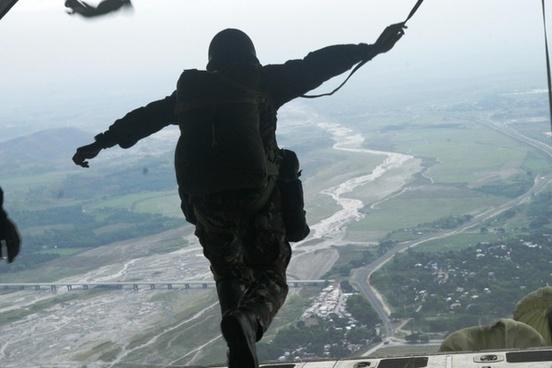 parachutist parachuting jumping out of plane
