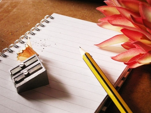pencil notebook writing