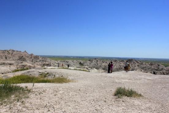 people looking down at formations at badlands national park south dakota