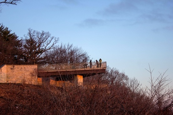 people on the balcony watching the sunrise at pikes peak state park iowa