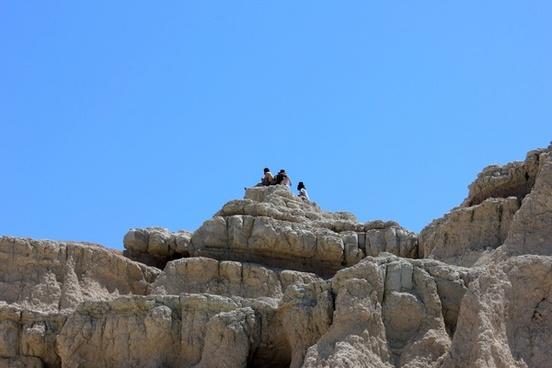 people on the peak at badlands national park south dakota