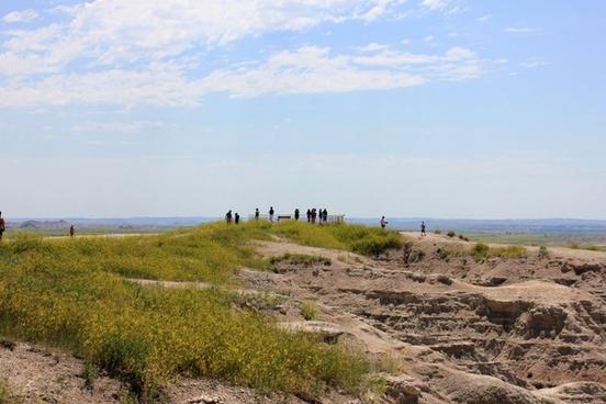 people overlooking the landscape at badlands national park south dakota