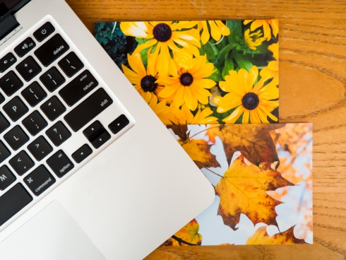 photo prints under laptop