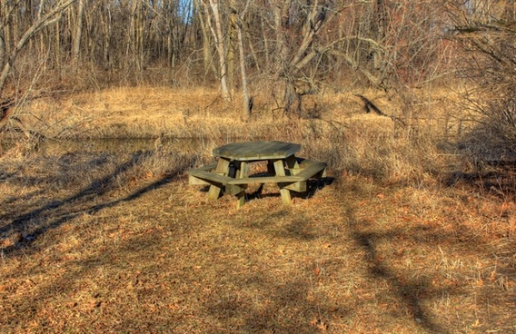 picnic table by the river on the 400 trail in wisconsin