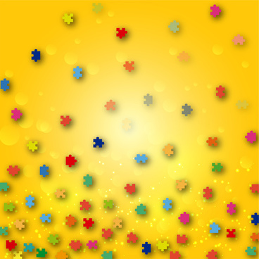 pieces of coloured jigsaw puzzle on yellow background