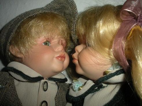 porcelain dolls kissing close up