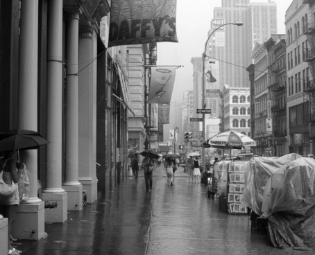 rain on broadway soho new york city bw