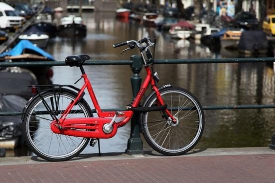 red bicycle on bridge