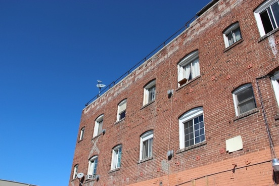 red brick apartment building on clear sky