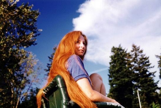 red hair against a blue sky