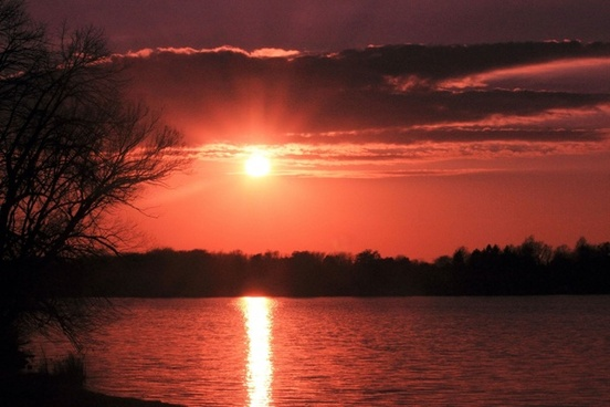 red sun over lake at pike lake state park wisconsin