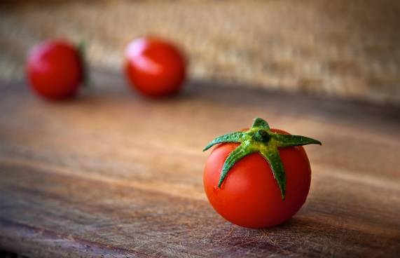red tomato on a wood table