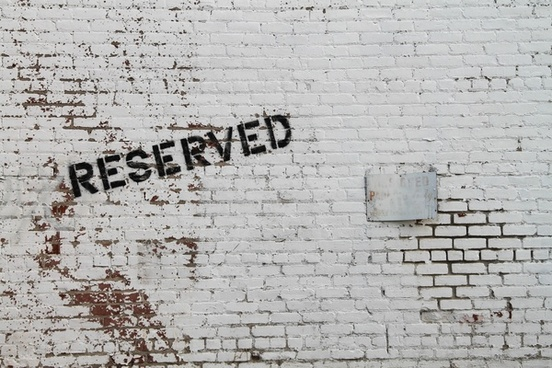 reserved painted on white brick wall