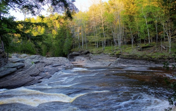 river flowing downstream at porcupine mountains state park michigan