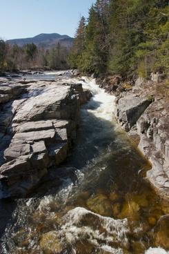 river rocks trees mountains