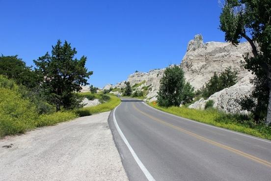 road through the badlands at badlands national park south dakota