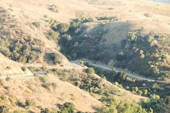 road winding through dry hills