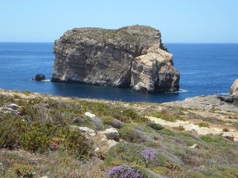 rock in the sea rock stone