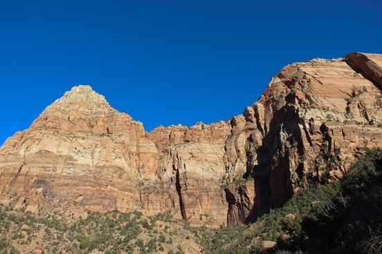 rock mountain cliffs on clear blue sky