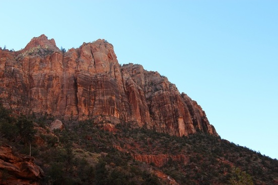 rocky mountain cliffs on blue sky