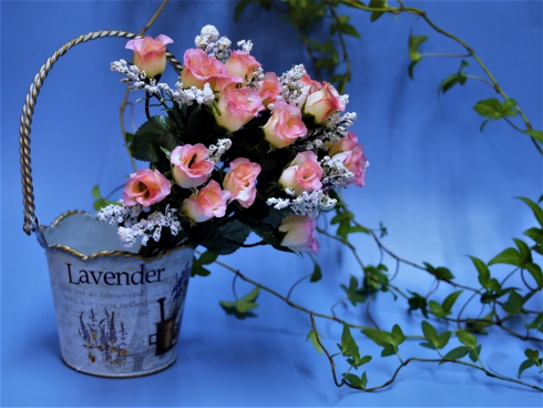 romantic decoration with basket and pink roses