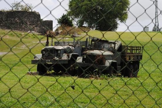 rusting army trucks