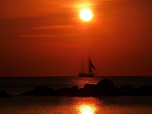sail ship at sunset