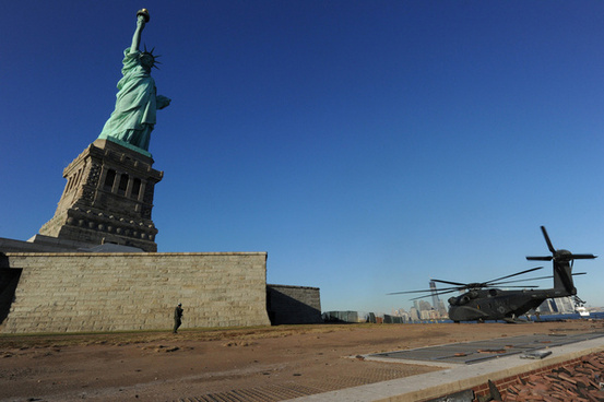 sailors assist with hurricane sandy clean up