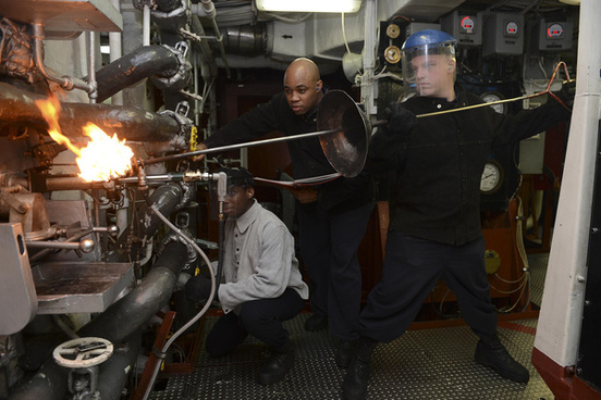 sailors light the boiler aboard uss bonhomme richard
