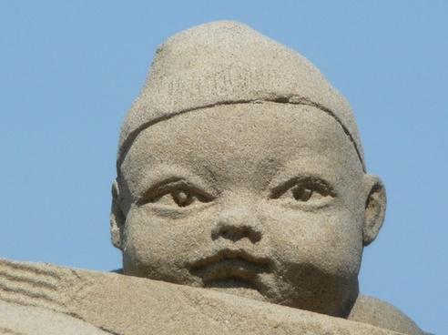 sand sculpture baby face
