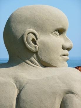 sand sculpture man face