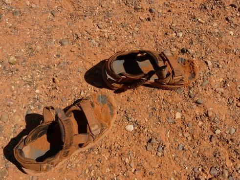 sandals shoes dirt