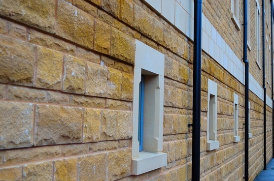 sandstone wall and windows