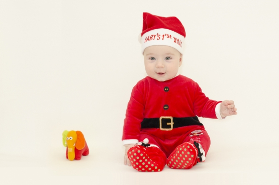 cute baby in santa claus clothing