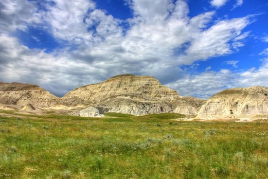 scattered clouds over a peak at white butte north dakota