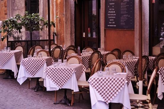 set tables in an italian restaurant