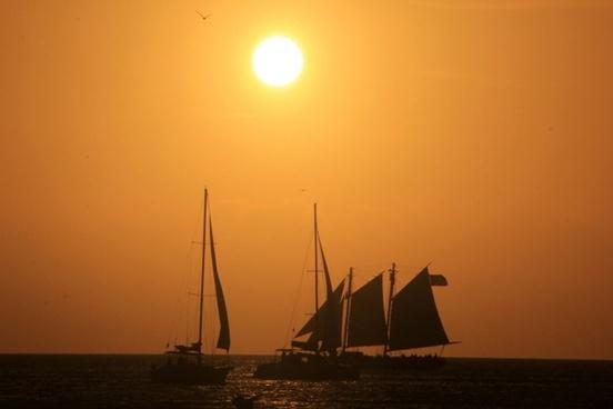 ships sun sunset