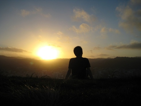 silhouette of guy watching sunset