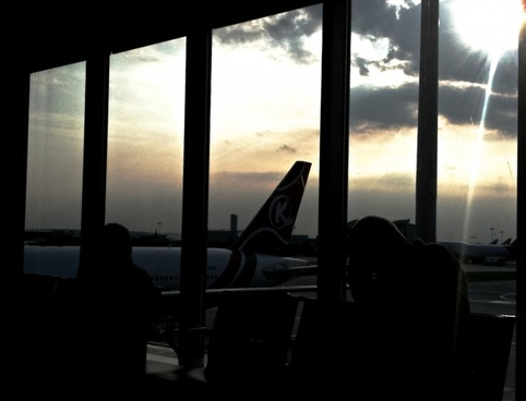 silhouette of plane tail at airport