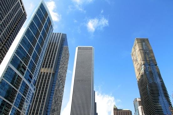 skyscrapers rising into blue sky