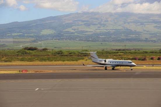 small jet airplane on runway at airport