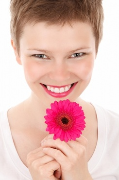 smiling woman with a flower
