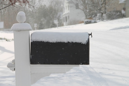 snow covered mailbox in neighborhood