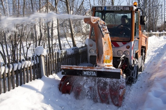 snow thrower clearing snow winter