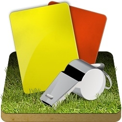 Soccer referee grass